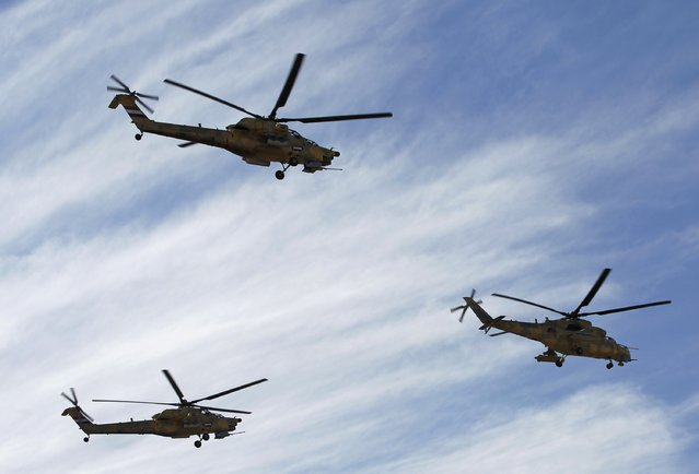 Iraqi Air Force helicopters fly past during the Iraqi Army Day's anniversary celebration in Baghdad January 6, 2015. (Photo by Thaier al-Sudani/Reuters)