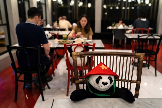 People have dinner as they sit next to stuffed panda dolls, used as part of social distancing measures to prevent the spread of the coronavirus disease (COVID-19), at the Maison Saigon restaurant that reopened after the easing of restrictions in Bangkok, Thailand, May 13, 2020. (Photo by Athit Perawongmetha/Reuters)