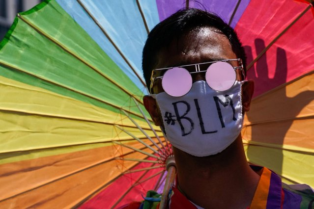 A demonstrator wears a face mask during a joint LGBTQ and Black Lives Matter march on the 51st anniversary of the Stonewall riots in New York City, New York, U.S. June 28, 2020. (Photo by Eduardo Munoz/Reuters)