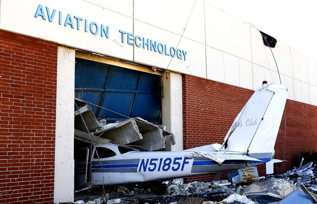 An airplane is damaged in the Aviation Technology building on the campus of the Canadian Valley Technology Center in El Reno, Oklahoma, on June 2, 2013, after a massive tornado roared through the area on Friday causing widespread damage and flooding. (Photo by Alonzo Adams/Associated Press)