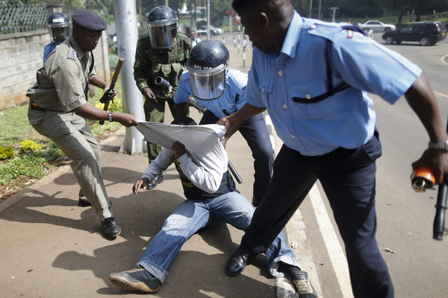 An activist is detained by police officers after others were dispersed during a demonstration against corruption in central Nairobi, Kenya, 01 December 2015. Kenyan president Uhuru Kenyatta on 23 November 2015 declared corruption a threat to national security, only days before the visit by Pope Francis who has called the country's corruption a 'path to death'. (Photo by Dai Kurokawa/EPA)