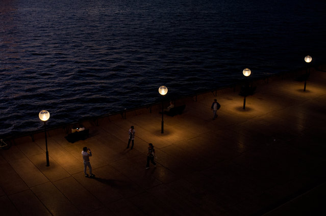 """Harbour Walk"". People pictured enjoying a warm late summer evening near the Sydney Opera House. May, 2013. (Photo and caption by Joel Ford/National Geographic Traveler Photo Contest)"