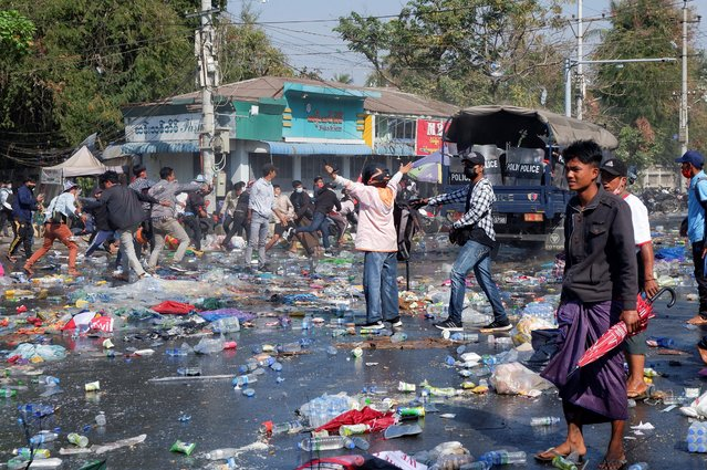 Demonstrators riot against police as they protest against the military coup in Mandalay, Myanmar, February 9, 2021. (Photo by Reuters/Stringer)