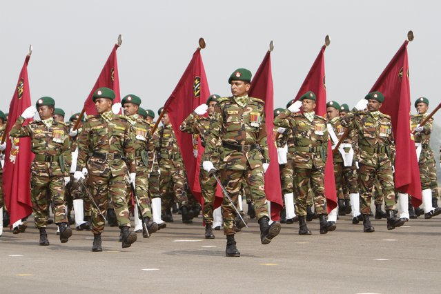 Bangladeshi army soldiers march past during the celebration of the country's 45th Victory Day  at the national parade ground in Dhaka December 16, 2015. (Photo by Ashikur Rahman/Reuters)