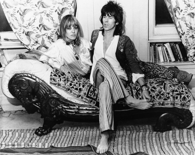 "Keith Richards of the Rolling Stones rock group and his German girlfriend Anita Pallenberg relax at his home in London, December 8, 1969, after he flew in from the U.S. where the group had been on tour. Miss Pallenberg complained that the British government had ordered her to marry Richards or get out of the country. The Home Office, which is responsible for deciding such things, said ""We cannot understand this complaint. We have informed Miss Pallenberg that her permit to stay in this country has been extended until next October. The usual steps were taken to inform her"". (Photo by Peter Kemp/AP Photo)"