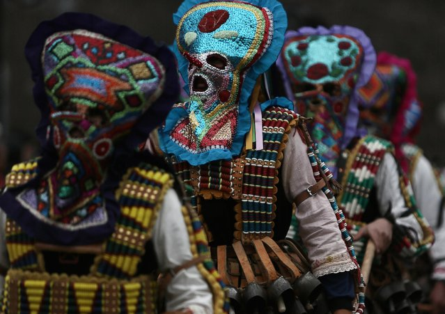 "Masked Bulgarian dancers take part in the second competition day of the 24th International Festival of Masquerade Games ""Surva"" in the town of Pernik, Bulgaria Saturday, January 31, 2015. (Photo by Valentina Petrova/AP Photo)"