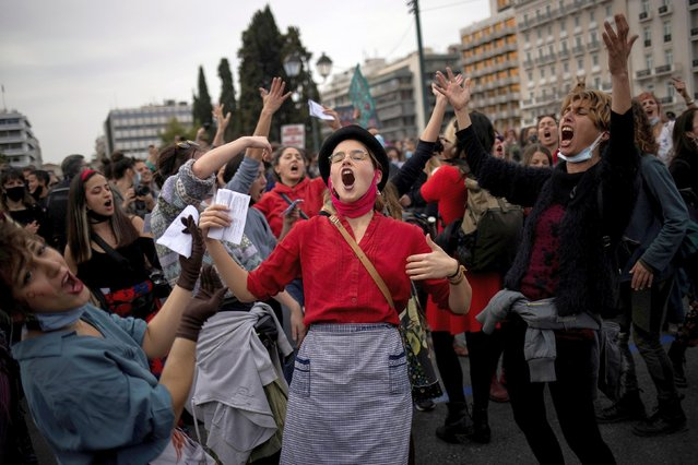 People dance and sing during a demonstration to mark International Women's Day in front of the parliament building in Athens, Greece, March 8, 2021. (Photo by Alkis Konstantinidis/Reuters)