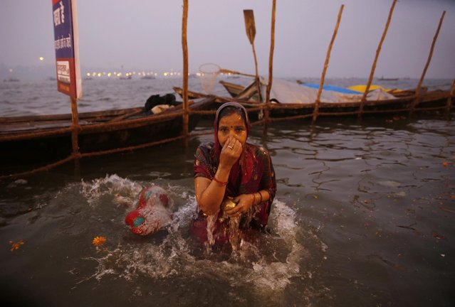 An Indian Hindu devotees takes a dip at the Sangam, on Basant Panchami, the fourth auspicious date of bathing, during the annual month-long Hindu religious fair of Magh Mela in Allahabad, India, India, Saturday, January 24, 2015. (Photo by Rajesh Kumar Singh/AP Photo)