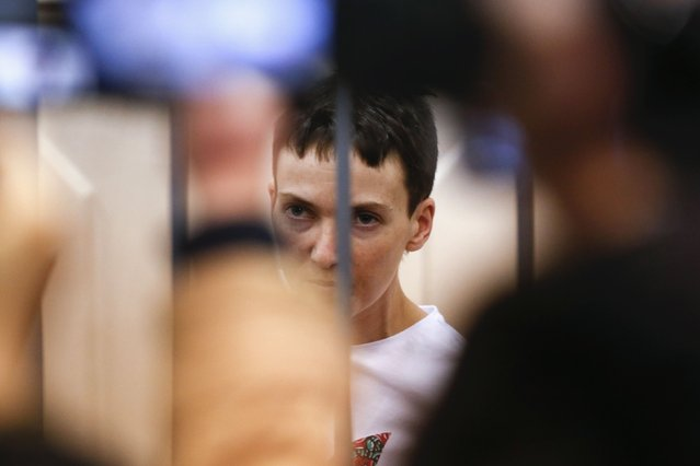 Ukrainian army pilot Nadezhda (Nadia) Savchenko looks out from a defendants' cage as she attends a hearing at the Basmanny district court in Moscow February 10, 2015. (Photo by Maxim Zmeyev/Reuters)