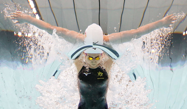 In this photo taken by underwater camera,  Japanese swimmer Rikako Ikee competes on way to winning the women's 100-meter butterfly at the Japan's national championships at Tokyo Aquatics Centre in Tokyo, Sunday, April 4, 2021. Ikee on Sunday qualified for the Tokyo Olympics just two years after the was diagnosed with leukemia. (Photo by Iori Sagisawa/Kyodo News via AP Photo)