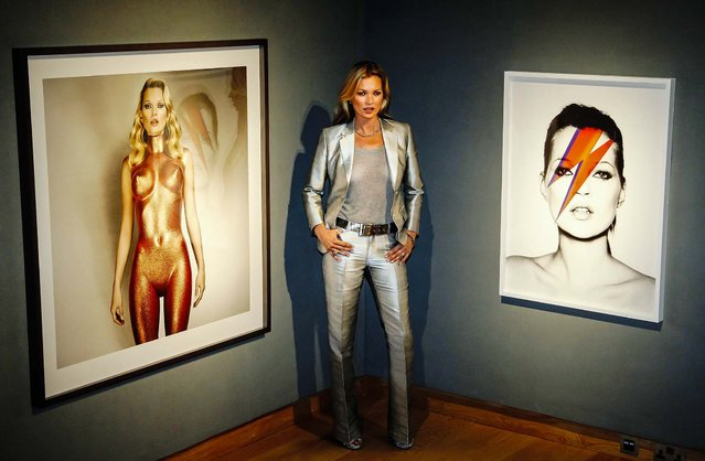 "Model Kate Moss poses with ""Body Armour"" (L) by photographer Allen Jones, and Kate ""Aladdin Sane"", 2003, by photographer Nick Knight, at Christie's auction house in London, on September 4, 2013. The work is estimated to fetch $42,000 in the sale ""A Celebration of Kate Moss"", from the collection of gallery owner Gert Elfering, in London on September 25. (Photo by Luke MacGregor/Reuters)"