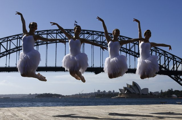 Ballerinas from The Australian Ballet perform on a floating platform, during a promotional event in front of the Sydney Opera House, February 18, 2015. The event was to promote the Australian Ballet's upcoming performance of Swan Lake opening on February 20. (Photo by David Gray/Reuters)