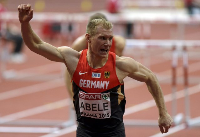 Arthur Abele of Germany crosses the finish line in the men's heptathlon 60 metres hurdles event during the IAAF European Indoor Championships in Prague March 8, 2015. REUTERS/David W Cerny (CZECH REPUBLIC  - Tags: SPORT ATHLETICS)