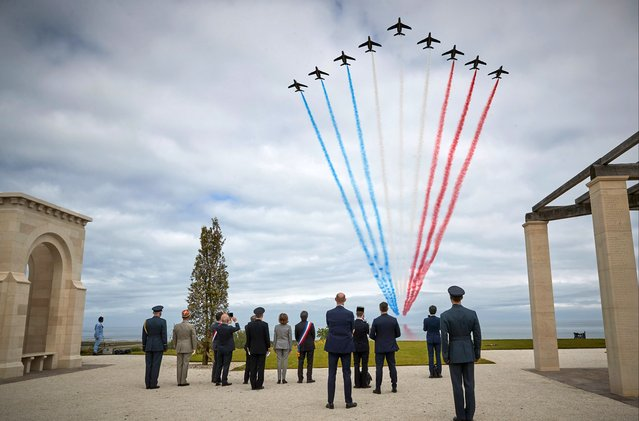 The Patrouille de France fly over The British Normandy Memorial during the opening ceremony on the 77th anniversary of D-Day on June 06, 2021 in Ver-sur-Mer Normandy, France. The British Normandy Memorial, officially opened today, is inscribed with the names of 22,442 men and women who lost their lives during the invasion of France in the summer of 1944 and is the first memorial in Normandy to commemorate those who fell under British Command. (Photo by Kiran Ridley/Getty Images for Normandy Memorial Trust)