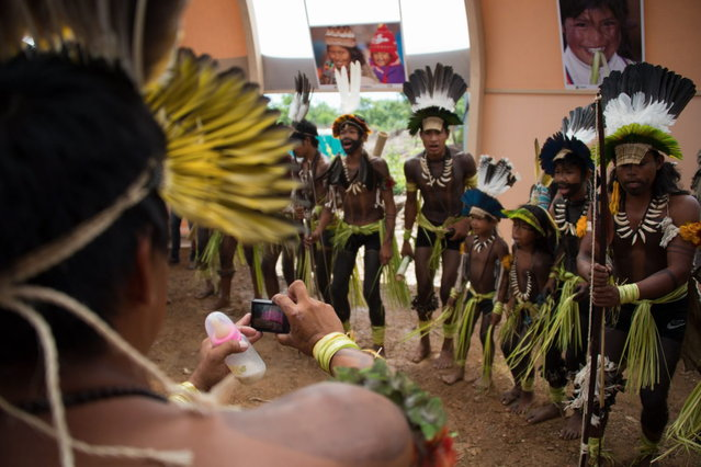 Children from the Brazilian Umutina tribe sing and dance before the visit of Brazilian Sport Minister Aldo Rebelo at the XIIth Games for Indigenous People in Cuiaba, Mato Grosso state, on 13 November, 2013 Brazil. (Photo by Christophe Simon/AFP Photo)