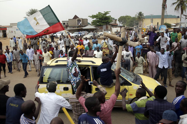 Nigerians celebrate the anticipated victory of Presidential candidate Muhammadu Buhari in Kaduna, Nigeria Tuesday, March 31, 2015. (Photo by Jerome Delay/AP Photo)