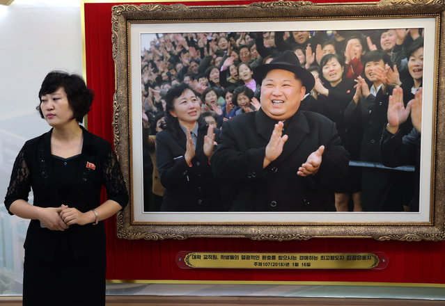 A photograph of North Korea' s Supreme Leader Kim Jong- un on display inside a cosmetics factory building in Pyongyang, North Korea on September 7, 2018. (Photo by Alexander Demianchuk/TASS)
