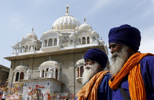 Sikh devotees participate in the Baisakhi festival at Panja Sahib shrine in Hassan Abdel April 13, 2015. (Photo by Caren Firouz/Reuters)