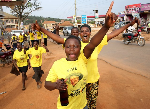 Supporters of Ugandan President Yoweri Museveni celebrate his election victory in Kampala, Uganda February 20, 2016. Ugandan President Yoweri Museveni extended his 30-year rule on Saturday, winning an election that international observers said lacked transparency and his main opponent, who was placed under house arrest, denounced as a sham. (Photo by Goran Tomasevic/Reuters)