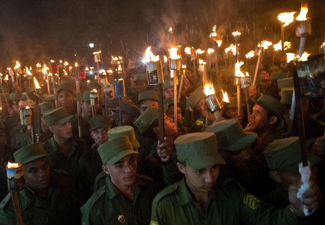 Thousands take part in the March of the Torches in remembrance of national independence hero Jose Marti's 166th birthday, and also pay tribute to the late revolutionary leader Fidel Castro, in Havana, Cuba, Monday, January 28, 2019. (Photo by Ramon Espinosa/AP Photo)
