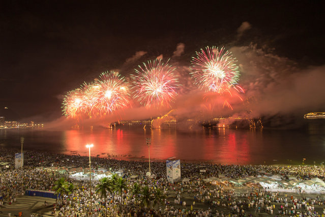 Fireworks light up the sky near Copacabana of Rio de Janeiro ringing in the New Year in Brazil, January 1, 2014. (Photo by Xu Zijian/Xinhua/ZumaPress.com)
