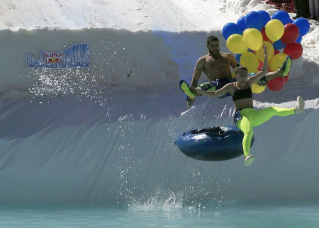 A couple participates in the Red Bull Jump & Freeze Lebanon at Mzaar Kfardebian Ski Resort in mount Lebanon February 28, 2016. (Photo by Jamal Saidi/Reuters)
