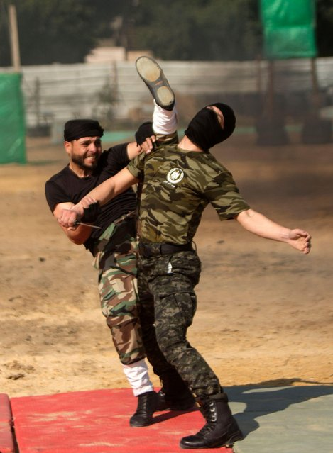 Members of the Palestinian Hamas security forces show their skills as they take part in a graduation ceremony in Gaza City on January 22, 2017. (Photo by Mahmud Hams/AFP Photo)