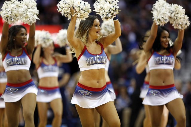 The New Orleans Pelicans Dance Team in the second half of an NBA basketball game in New Orleans, Monday, December 26, 2016. (Photo by Tyler Kaufman/AP Photo)