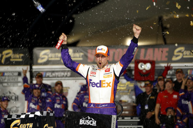 NASCAR Cup Series driver Denny Hamlin (11)celebrates in victory lane after winning a NASCAR Cup Series auto race at the Las Vegas Motor Speedway Sunday, September 26, 2021, in Las Vegas. (Photo by Steve Marcus/AP Photo)