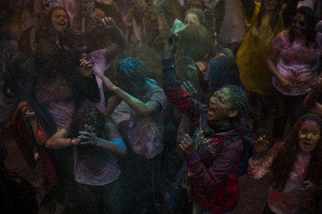 Revelers shout and throw coloured powder during a Holi Festival in Madrid, Spain, Sunday, April 26, 2015. (Photo by Andres Kudacki/AP Photo)