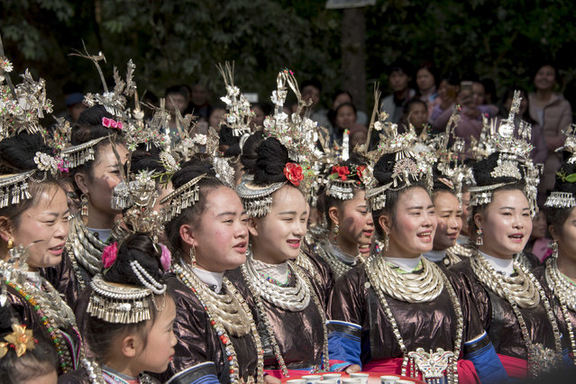In this photo taken on January 28, 2017, Dong ethnic minority women celebrate the Lunar New Year in Congjiang, Guizhou province. China is marking the beginning of the Lunar New Year, the Year of the Rooster. (Photo by AFP Photo/Stringer)