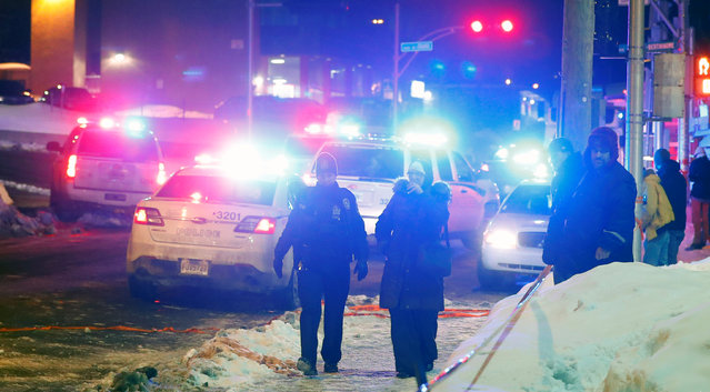 Police officers are seen near a mosque after a shooting in Quebec City, January 29, 2017. (Photo by Mathieu Belanger/Reuters)