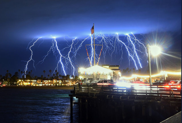 This time exposure photo provided by the Santa Barbara County Fire Department shows a series of lightning strikes over Santa Barbara, Calif., seen from Stearns Wharf in the city's harbor, Tuesday evening, March 5, 2019. A storm soaking California on Wednesday could trigger mudslides in wildfire burn areas where thousands of residents are under evacuation orders, authorities warned. (Photo by Mike Eliason/Santa Barbara County Fire Department via AP Photo)