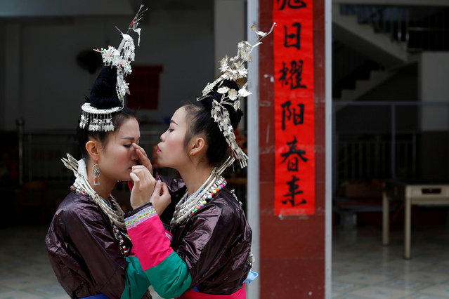 "Ethnic ""Kam"" (also known as Dong) women get ready for a traditional wedding ritual known as the ""steal the chicken at the drum tower"" in a minority Dong village in southwestern Chinese city of Congjiang, Guizhou province, China January 29, 2017. The ceremony held in the ethnic Kam minority village of Gantuan in Guizhou province is based on a tradition dating back some 500 years that was revived and modified in the 1990s for villagers and tourists. (Photo by Tyrone Siu/Reuters)"