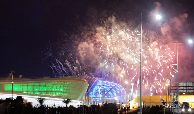 Fireworks are shot over Fisht Olympic Stadium, right, and Adler Arena, left, at the conclusion of a rehearsal for the opening ceremony at the 2014 Winter Olympics, Saturday, February 1, 2014, in Sochi, Russia. (Photo by David Goldman/AP Photo)