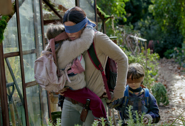 "This image released by Netflix shows Sandra Bullock in a scene from ""Bird Box"", a film which will have an exclusive run in theaters before becoming available on Netflix's streaming service. (Photo by Saeed Adyani/Netflix via AP Photo)"