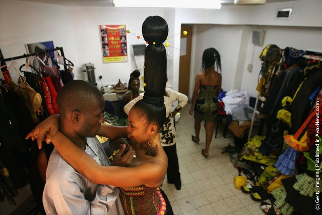A Nigerian fashion model hugs her makeup artist during a fashion show to promote ethnic fashion June 13, 2006 in Tel Aviv, Israel