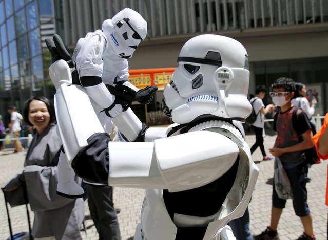 A cosplayer dressed up as Star Wars character Storm Trooper takes part in a Star Wars Day fan event in Tokyo May 4, 2015. (Photo by Toru Hanai/Reuters)