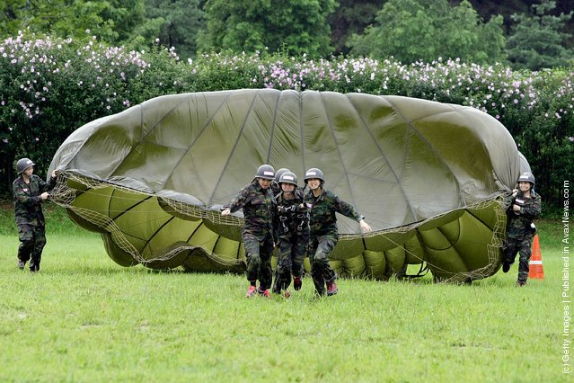 South Korean teenagers participate in a warfare exercise as part of the Special Warfare Command's training course at a military base