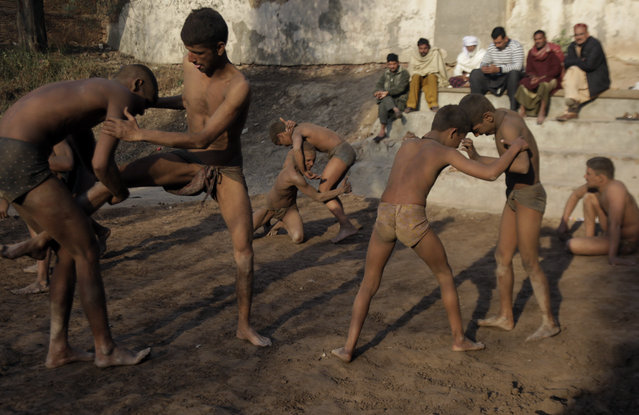 Wrestlers practice the national sport of Kushti during a training session, in Lahore, Pakistan, Monday, January 28, 2019. Kushti, also known as Pehlwani, is a several thousand year-old sport and is practiced in the Indian subcontinent. The wrestlers train and compete on dirt floors, cleared of stones and dyed red. (Photo by K.M. Chaudary/AP Photo)