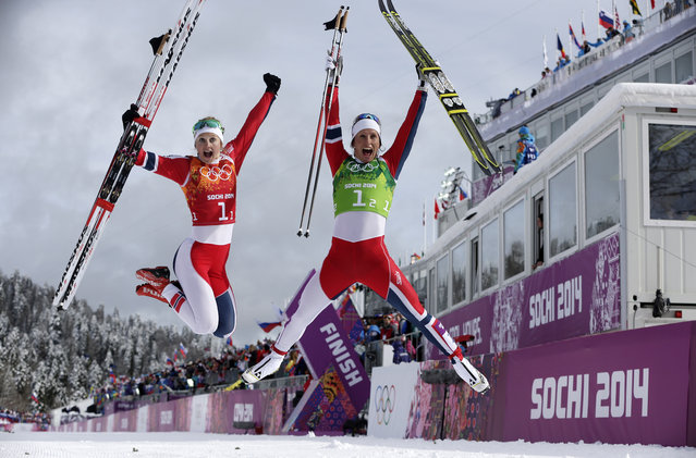 Norway's Ingvild Flugstad Oestberg, left, and Marit Bjoergen celebrate winning the gold after the women's cross-country team sprint competitions at the 2014 Winter Olympics, Wednesday, February 19, 2014, in Krasnaya Polyana, Russia. (Photo by Matthias Schrader/AP Photo)