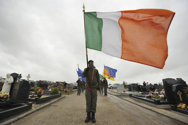 Masked members of Republican Sinn Fein commemorate the 100 year anniversary of the Irish Easter Rising in Lurgan, Northern Ireland March 26, 2016. (Photo by Clodagh Kilcoyne/Reuters)