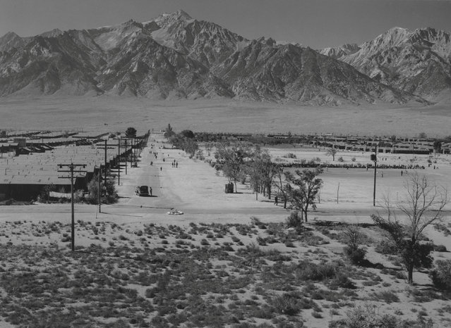 A bird's-eye view of grounds from the guard tower; view west, showing buildings, roads, and the Sierra Nevada mountains in the background at the Manzanar War Relocation Center in California, in this 1943 handout photo. (Photo by Courtesy Ansel Adams/Library of Congress, Prints and Photographs Division/Reuters)