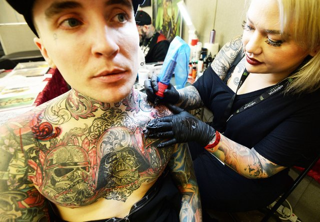 James Naden is already covered in tattoos but gets one more to add to his collection at the 2017 Tattoo Collective event at the Old Truman Brewery in London, England on February 17, 2017. (Photo by PA Wire)