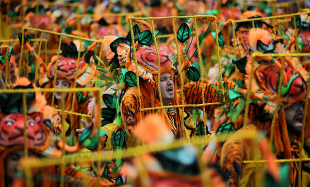 Revellers parade for the Aguia de Ouro samba school during the carnival in Sao Paulo, Brazil, February 25, 2017. (Photo by Paulo Whitaker/Reuters)