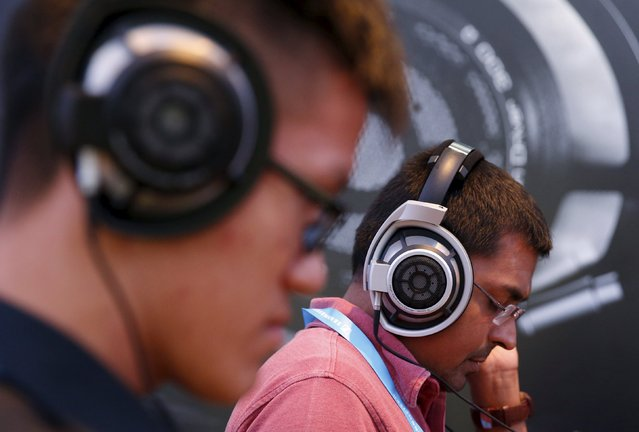 People test headphones during the CanJam headphone and personal audio expo in Singapore February 21, 2016. (Photo by Edgar Su/Reuters)