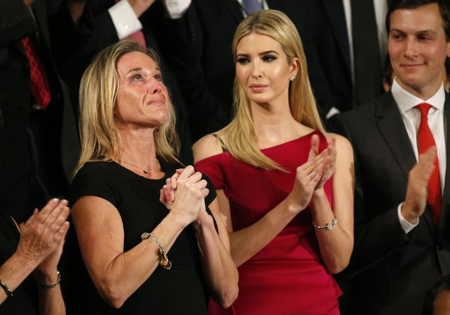 """Carryn Owens (L), widow of Senior Chief Petty Officer William """"Ryan"""" Owens, reacts as Ivanka Trump, daughter of U.S. President Donald Trump, and her husband Jared Kushner (R), applaud after Owens was mentioned by President Trump in Washington, U.S. on February 28, 2017. (Photo by Kevin Lamarque/Reuters)"""