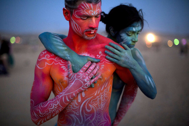 A picture made available on 24 May 2015 shows Israeli painted artists during the Israel Midburn festival in the Negev desert southern Israel, 23 May 2015. About 6,000 people attended the colorful festival which is the Israeli version of the well known Burning man festival in Nevada, USA. (Photo by Abir Sultan/EPA)