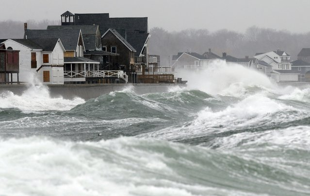 Wind-driven waves come ashore in Scituate, Mass., Wednesday, March 26, 2014. Cape Cod and the islands were expected to bear the brunt of the spring storm that struck full force Wednesday. The strom could drop up to 10 inches of snow. (Photo by Michael Dwyer/AP Photo)