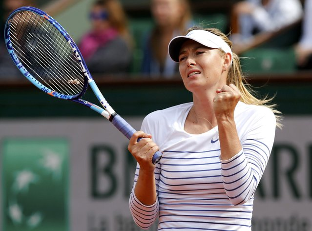 Maria Sharapova of Russia reacts during the women's singles match against Kaia Kanepi of Estonia at the French Open tennis tournament at the Roland Garros stadium in Paris, France, May 25, 2015. (Photo by Jean-Paul Pelissier/Reuters)